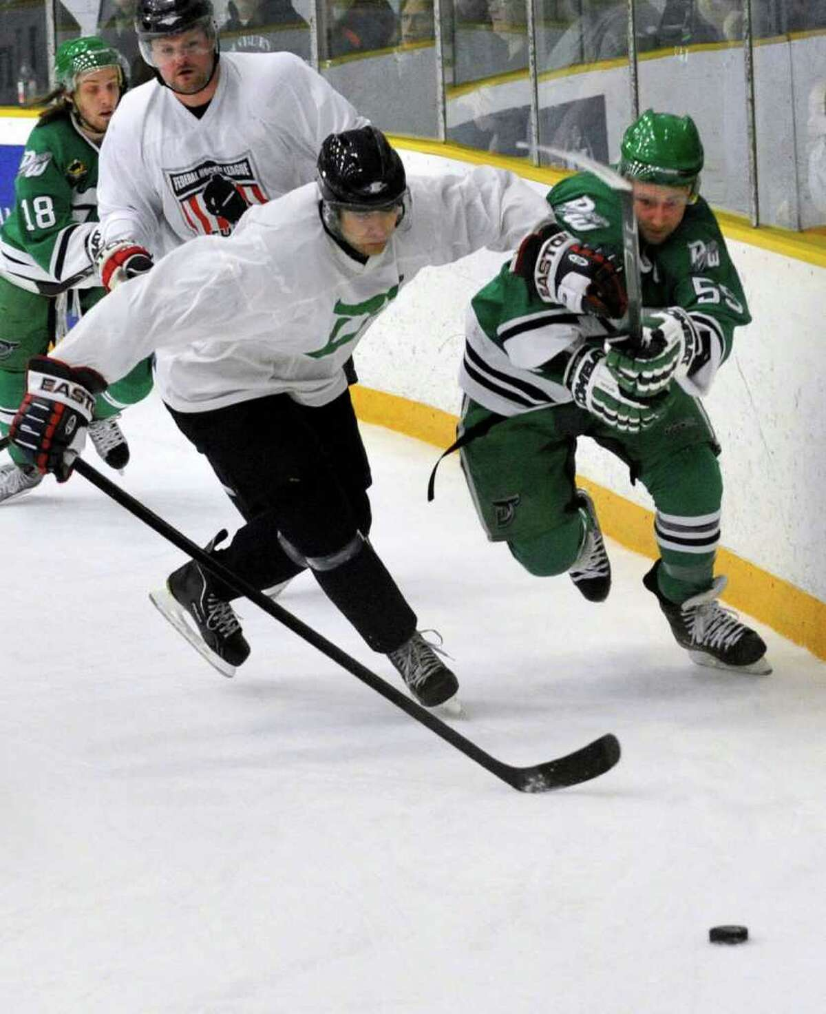 Danbury's James Sanford battles Delaware's Nicolas Katsiyianis for the puck during their game at Danbury Arena on Saturday, March 3, 2012.