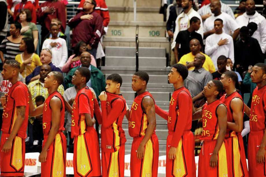 The Yates Lions lineup prior to the first half of a 4A regional final high school basketball game between the Jack Yates High School Lions and the Jesse H. Jones High School Falcons, Saturday, March 3, 2012 at the Merrell Center in Katy, Texas. Yates leads at the half 62-37. Photo: TODD SPOTH, For The Chronicle / © TODD SPOTH, 2012