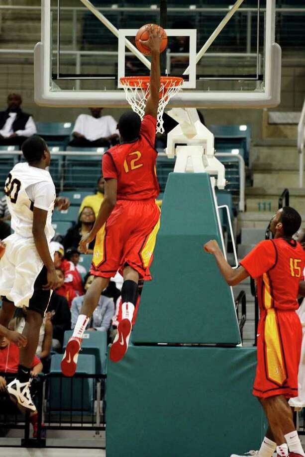 Yates' Melvin Swift, 12, slam dunks the ball during the first half of a 4A regional final high school basketball game between the Jack Yates High School Lions and the Jesse H. Jones High School Falcons, Saturday, March 3, 2012 at the Merrell Center in Katy, Texas. Yates leads at the half 62-37. Photo: TODD SPOTH, For The Chronicle / © TODD SPOTH, 2012