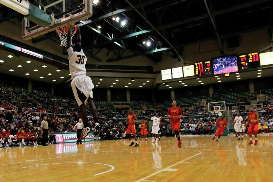 Jones' Broderick Harris, 30, slam dunks the ball during the first half of a 4A regional final high school basketball game between the Jack Yates High School Lions and the Jesse H. Jones High School Falcons, Saturday, March 3, 2012 at the Merrell Center in Katy, Texas. Yates leads at the half 62-37. Photo: TODD SPOTH, For The Chronicle / © TODD SPOTH, 2012