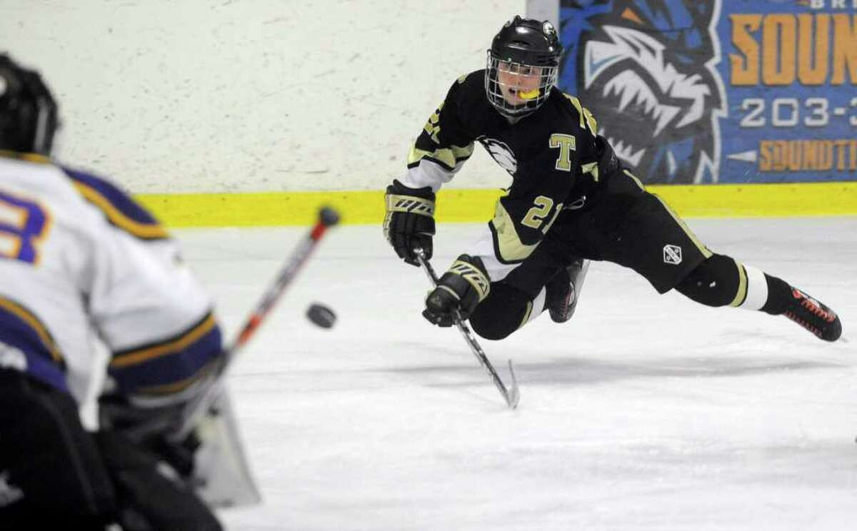 Trumbull's Nate Walker takes a shot against Westhill during Saturday's FCIAC Teir II Boys Hockey Final at Terry Conners Rink in Stamford on March 3, 2012.