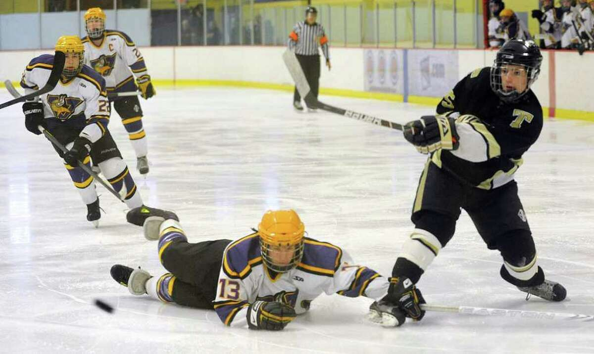 Trumbull's Michael Ahearn takes a shot as Westhill's Scott Reville dives for the puck during Saturday's FCIAC Teir II Boys Hockey Final at Terry Conners Rink in Stamford on March 3, 2012.