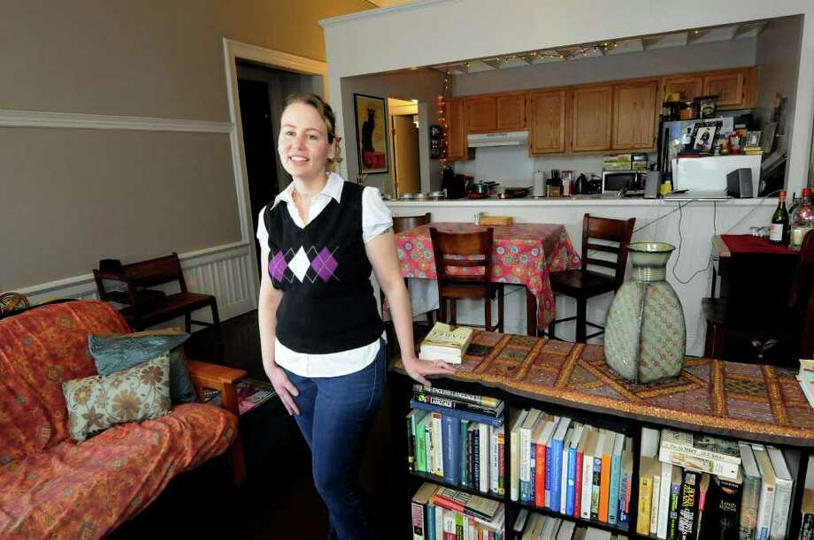 Heather Hewitt stands in her two-bedroom moderate-income apartment on Wednesday, Feb. 15, 2012, at 77 Adams St. in Troy, N.Y. (Cindy Schultz / Times Union) Photo: Cindy Schultz / 00016436A