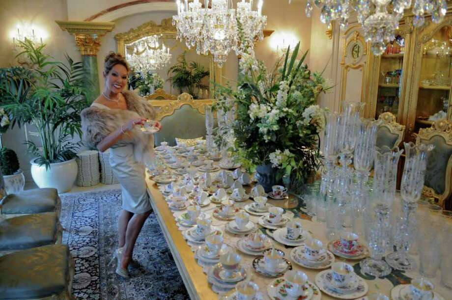 Michele Riggi prepares for an upcoming wedding shower for her daughter, in her home on Tuesday Jan. 31, 2012 in Saratoga Springs, NY.  (Philip Kamrass / Times Union ) Photo: Philip Kamrass / 00016257A