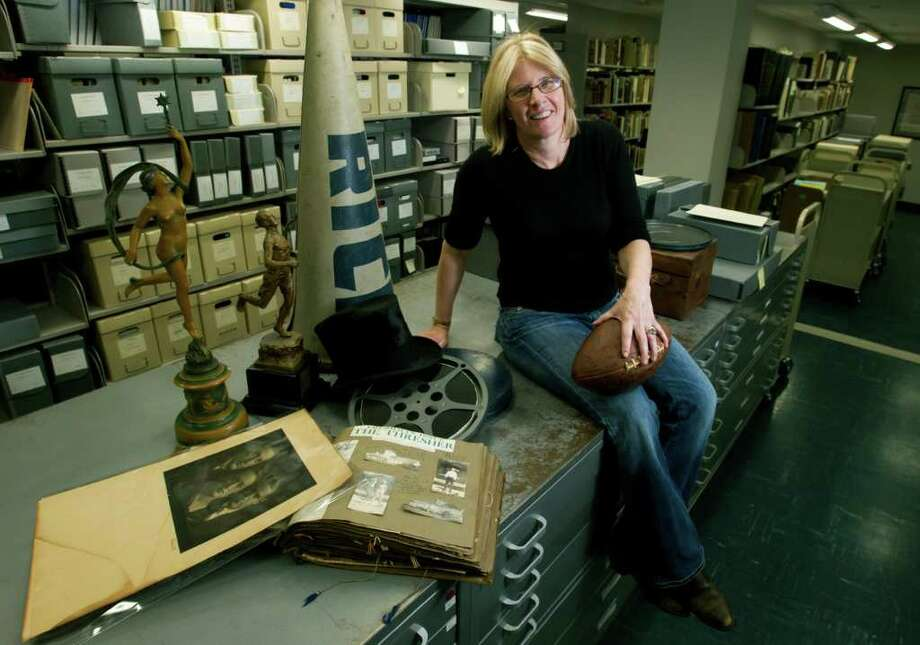 Melissa Kean takes a break in the  Woodson Research Center. As Rice University's official historian preparing for the school's 100th anniversary celebration, Kean has found a treasure trove of items all over the campus. Photo: Brett Coomer / © 2012 Houston Chronicle