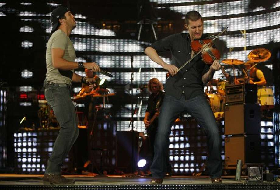 Luke Bryan performs at the Houston Livestock Show and Rodeo at Reliant Stadium on Saturday, March 3, 2012, in Houston.  ( Mayra Beltran / Houston Chronicle ) (Mayra Beltran)