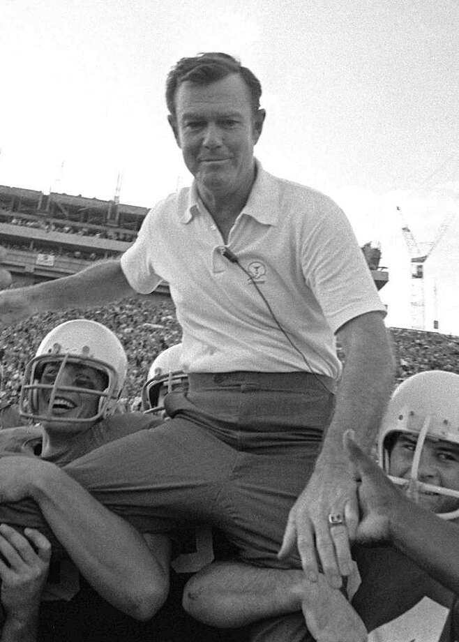 Coach Darrell Royal is carried from the field on the shoulders of Texas players following Texas' 42-7 triumph over Arkansas in Austin, Tx., in this Dec. 5, 1970 in Austin, Tx. (AP Photo/File) / AP