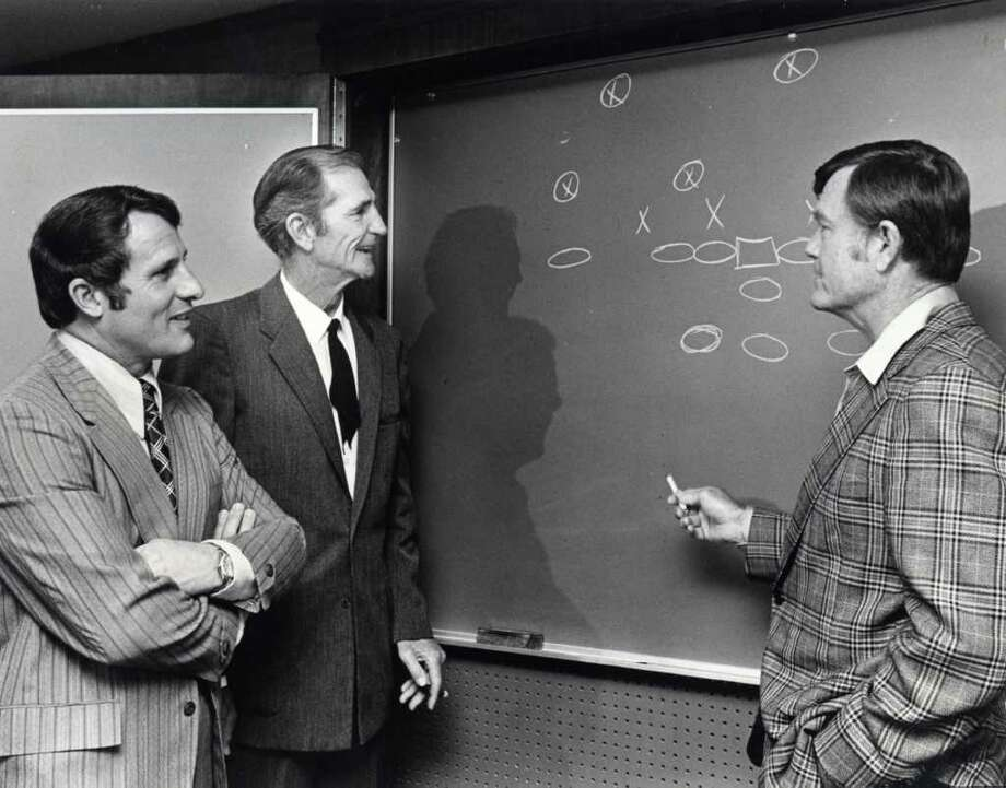 Texas A&M head football coach Emory Bellard, former football player Sammy Baugh, and University of Texas coach Darrell Royal at the Houston Touchdown Club meeting, Wednesday, November 27, 1974. David Nance / Houston Chronicle Photo: David Nance / Houston Chronicle