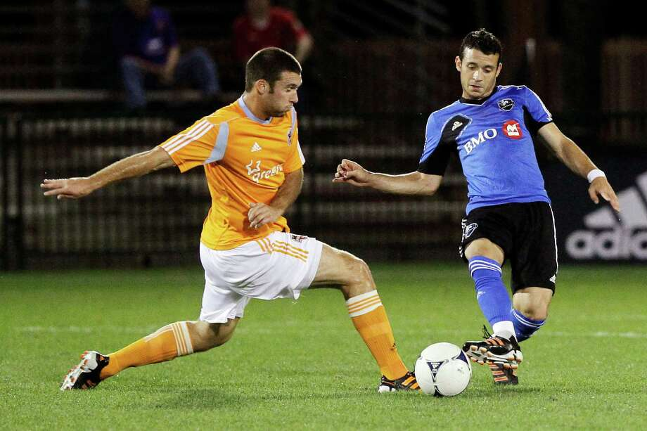 Dynamo forward Will Bruin, left, doesn't believe he has endured a sophomore slump so far this season, but he readily admitted Sunday's goal in a 1-1 tie with the Fire took the weight of the world off his shoulders. Photo: John Raoux / AP