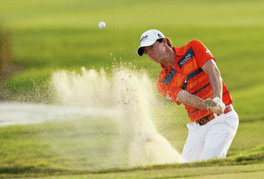 Rory McIlroy caps a 4-under 66 effort Saturday by blasting out of a bunker and earning a birdie on No. 18 to forge a two-shot lead in the Honda Classic. Photo: Mike Ehrmann / 2012 Getty Images