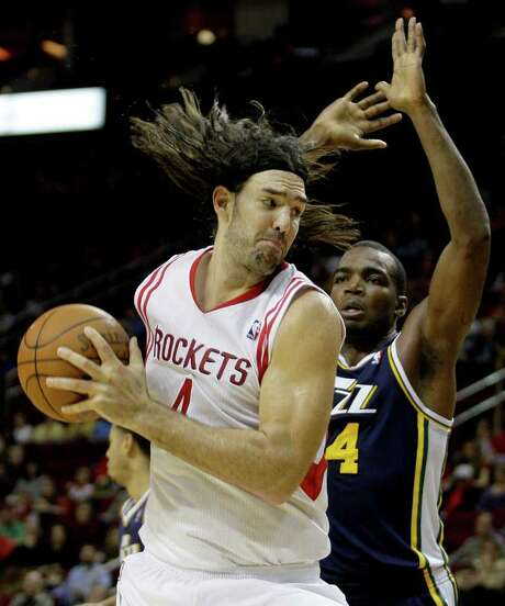 Forward Luis Scola, left, senses trouble if the Rockets continue their poor play of the past two losses in which they were outworked by the Jazz and Nuggets. Photo: Thomas B. Shea / © 2011 Thomas B. Shea