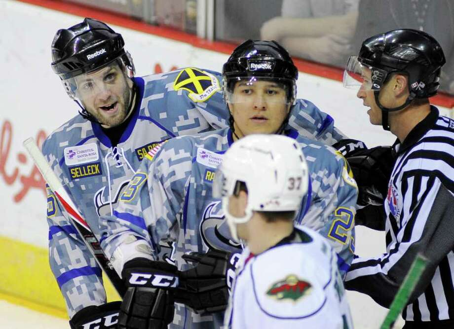 San Antonio Rampage's Eric Selleck, left, mouths off to Houston Aeros' Justin Fontaine during the second period of an AHL hockey game, Saturday, March 3, 2012, in San Antonio. Photo: Darren Abate, Darren Abate/pressphotointl.com / Darren Abate/pressphotointl.com