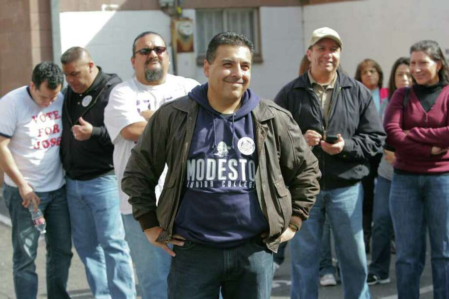 Jose Hernandez, shown here at a a rally before union supporters, is running for a House seat in California after resigning from the astronaut program. His family remains in Houston for the time being. Photo: Tomas Ovalle / ONLINE_YES