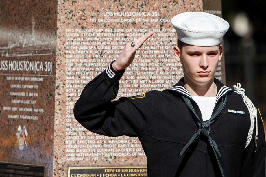 Caleb Hanley, 16, of the United States Naval Sea Cadet Corps salutes  during the memorial service for the 70th anniversary of the WWII USS Houston (CA-30) final 1942 battle off the coast of Java, at Sam Houston Park, Saturday, March 3, 2012, in Houston. Photo: Michael Paulsen, Houston Chronicle / © 2012 Houston Chronicle