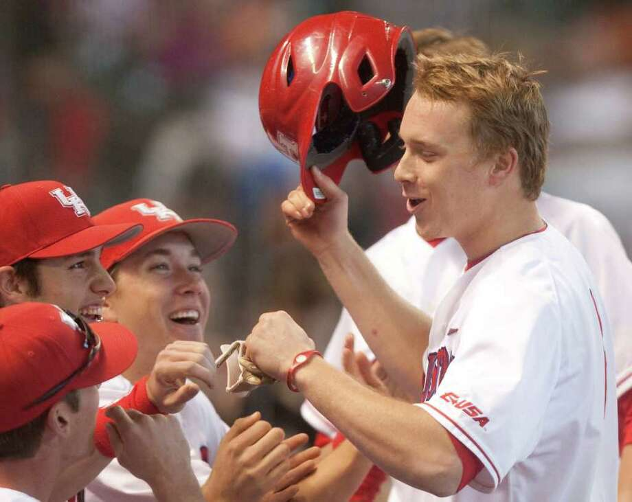 Houston's Cory Kay (4) receives a hero's welcome after homering in the third inning against Arkansas. Photo: J. Patric Schneider / Houston Chronicle