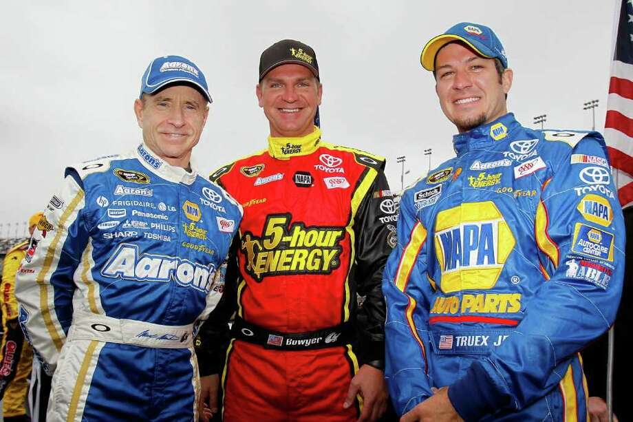 DAYTONA BEACH, FL - FEBRUARY 26:  Teammates Mark Martin, driver of the #55 Aaron's Toyota, Clint Bowyer, driver of the #15 5-Hour Energy Toyota, and Martin Truex Jr., driver of the #56 NAPA Auto Parts Toyota, pose on the grid prior to the start of the NASCAR Sprint Cup Series Daytona 500 at Daytona International Speedway on February 26, 2012 in Daytona Beach, Florida.  (Photo by Todd Warshaw/Getty Images for NASCAR) Photo: Todd Warshaw / 2012 Getty Images