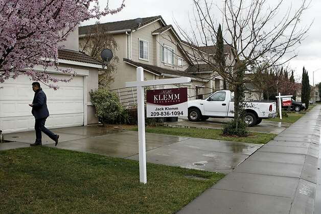 Realtor, Imran Poladi in the Weston Ranch neighborhood at a foreclosure home and short sale property, in Stockton, Ca. on Thursday Mar. 1, 2012. The City of Stockton, Ca. could be the largest city in the country to file for bankruptcy after the city council voted Tuesday night to begin mediations with service unions and creditors as required by state law. Photo: Michael Macor, SFC