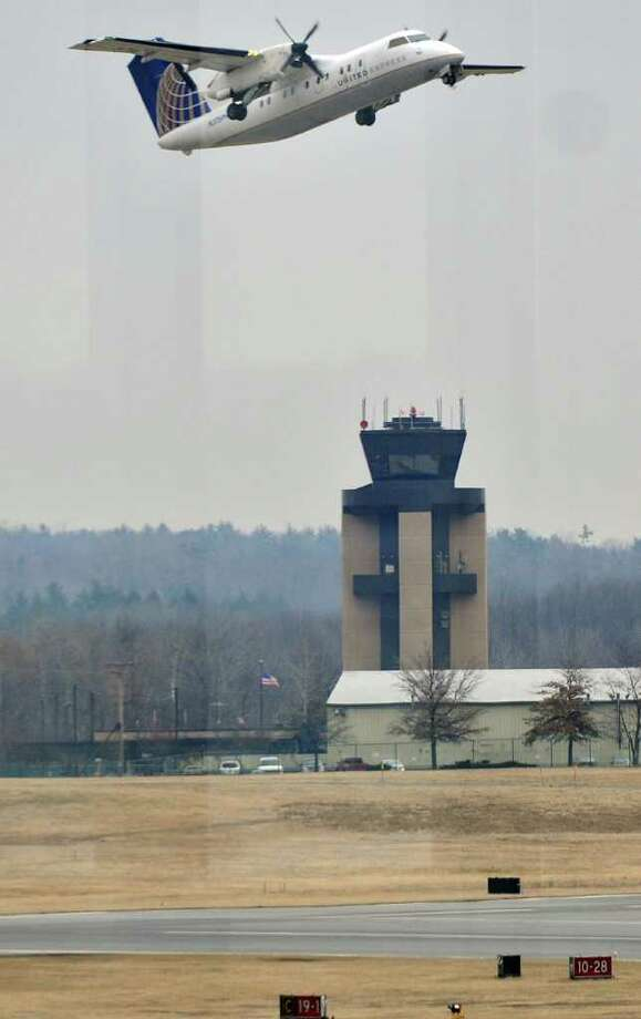 A United Express passenger plane departs from Albany International Airport on Wednesday Feb. 15, 2012 in Colonie, NY.  (Philip Kamrass / Times Union ) Photo: Philip Kamrass / 00016453A