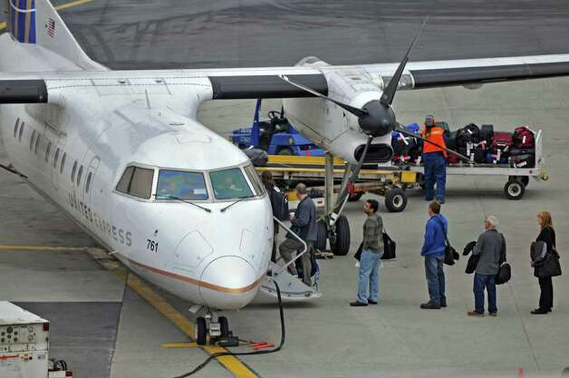 Passengers  board a United Express plane before departing from Albany International Airport on Wednesday Feb. 15, 2012 in Colonie, NY.  (Philip Kamrass / Times Union ) Photo: Philip Kamrass / 00016453A