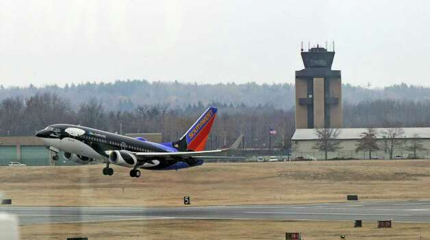 A Southwest Airlines takes off from Albany International Airport on Wednesday Feb. 15, 2012 in Colonie, NY.  (Philip Kamrass / Times Union ) Photo: Philip Kamrass / 00016453A