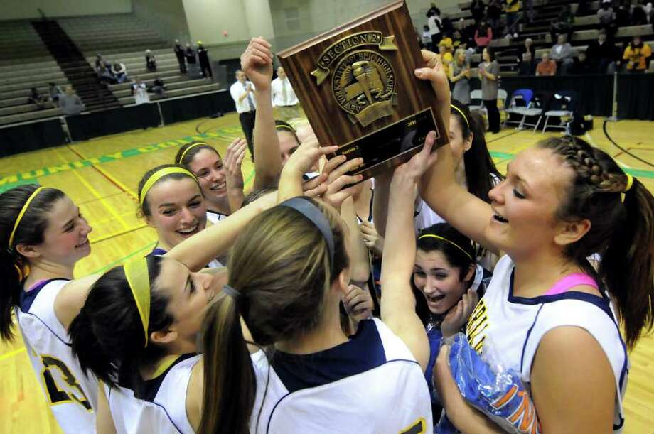 Averill Park's basketball team celebrates their Section II Class A 41-33 victory over Scotia on Saturday, March 3, 2012, at Hudson Valley Community College in Troy, N.Y. (Cindy Schultz / Times Union) Photo: Cindy Schultz / 00016621A