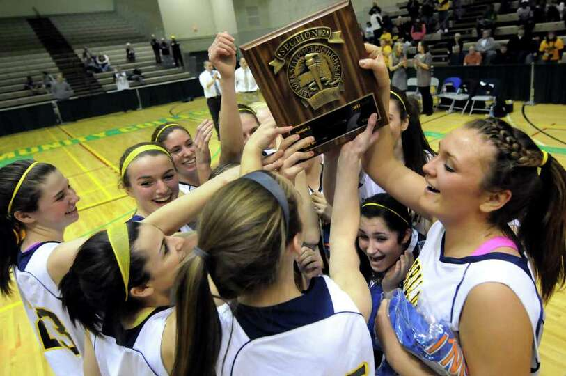 Averill Park's basketball team celebrates their Section II Class A 41-33 victory over Scotia on Satu