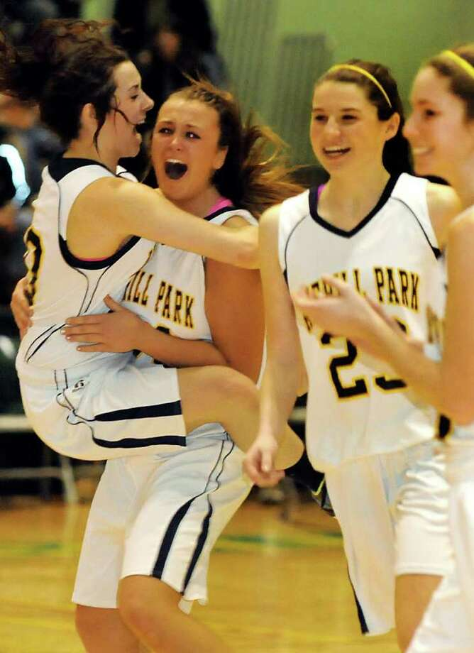 Averill Park's Elaina Ryan (30), left, leaps on teammate Bridget Carney (34), center, as they celebrate their Section II Class A basketball 41-33 victory over Scotia on Saturday, March 3, 2012, at Hudson Valley Community College in Troy, N.Y. (Cindy Schultz / Times Union) Photo: Cindy Schultz / 00016621A