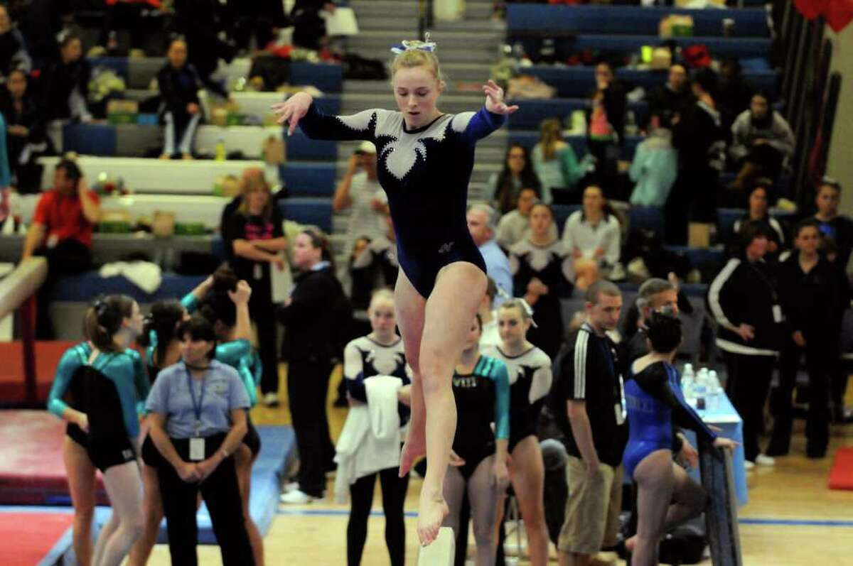 Rachel Van Earden of Saratoga competes on the beam representing Section II in the state gymnastics meet at Shaker High School in Colonie, N.Y. Saturday March 3, 2012.( Michael P. Farrell/Times Union)