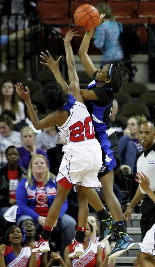 3/3/12-  Spring Dekaney's Kayla Nevitt (23) shoots over Duncanville's Tasia Foman (20) in the 5A Girls UIL state basketball state championship in Austin, Texas March 3, 2012. (Erich Schlegel/Special Contributor) Photo: Erich Schlegel, Houston Chronicle / ©2012 Erich Schlegel