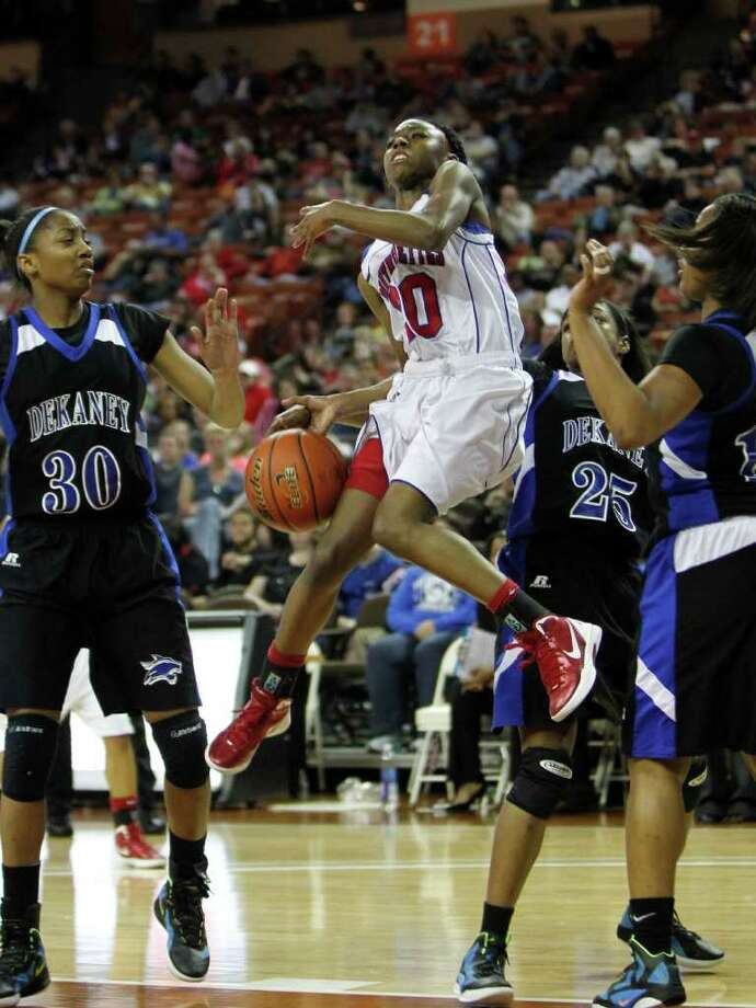 3/3/12  -  Duncanville's Tasia Foman (20) looses the ball going between Spring Dekaney's Shunta Nevitt (30) and Jaleesa Chapel (25) in the 5A Girls UIL state basketball state championship in Austin, Texas March 3, 2012. (Erich Schlegel/Special Contributor) Photo: Erich Schlegel, Houston Chronicle / ©2012 Erich Schlegel