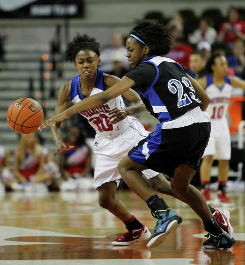 3/3/12  -  Duncanville's Tasia Foman (20) defends against Spring Dekaney's Kayla Nevitt (23) in the 5A Girls UIL state basketball state championship in Austin, Texas March 3, 2012. (Erich Schlegel/Special Contributor) Photo: Erich Schlegel, Houston Chronicle / ©2012 Erich Schlegel