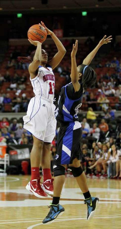 3/3/12  -  Duncanville's Ariel Atkins (12) shoots over Spring Dekaney's Jaleesa Chapel (25) in the 5A Girls UIL state basketball state championship in Austin, Texas March 3, 2012. (Erich Schlegel/Special Contributor) Photo: Erich Schlegel, Houston Chronicle / ©2012 Erich Schlegel