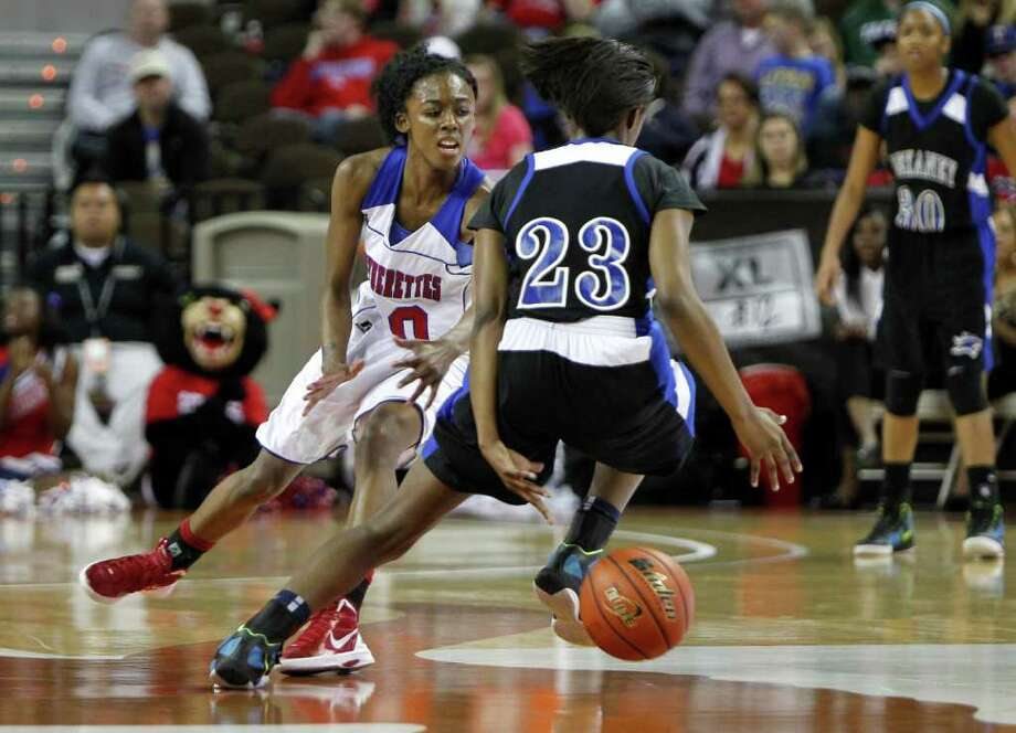 3/3/12  -  Spring Dekaney's Kayla Nevitt (23) dribbles behind her back to get around Duncanville's Tasia Foman (20) in the 5A Girls UIL state basketball state championship in Austin, Texas March 3, 2012. (Erich Schlegel/Special Contributor) Photo: Erich Schlegel, Houston Chronicle / ©2012 Erich Schlegel