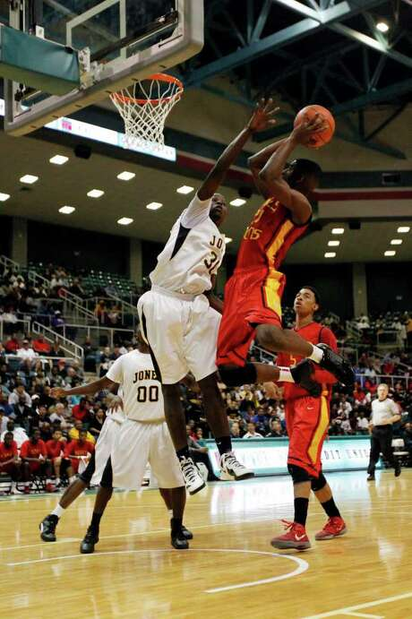 Yates' Daymean Dotson (21), who finished with 26 points, goes up for a shot against Jones' Broderick Harris (30) in the second half of Saturday night's game. Photo: TODD SPOTH / © TODD SPOTH, 2012