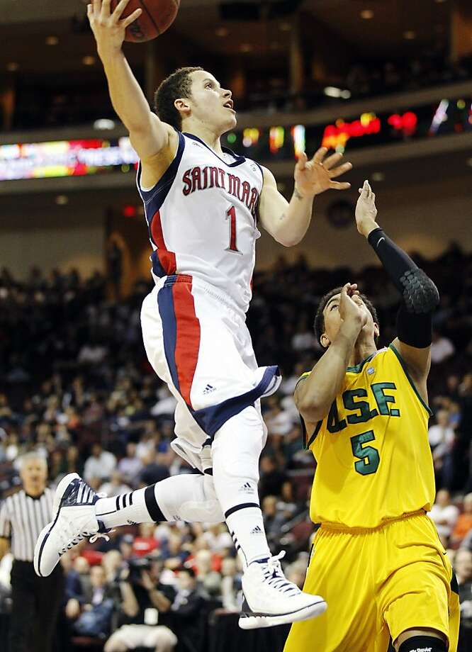Saint Mary's (Calif.) Jorden Page shoots over San Francisco's Michael Williams during the first half of an NCAA college basketball game at the West Coast Conference tournament on Saturday, March 3, 2012, in Las Vegas. (AP Photo/Isaac Brekken) Photo: Isaac Brekken, Associated Press