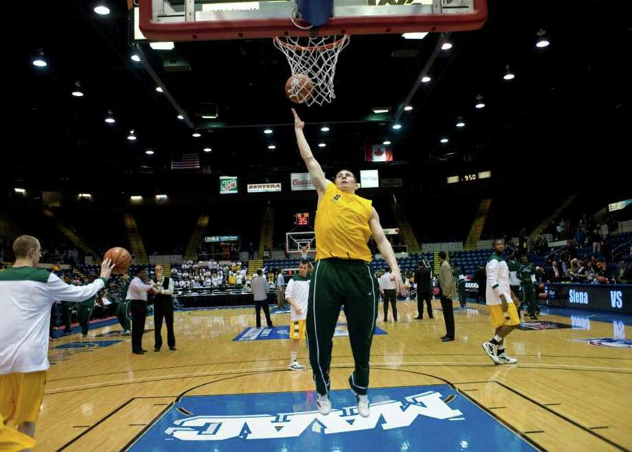 Siena's Kyle Downey warms up before of a MAAC men's quarterfinals college basketball game against Manhattan in Springfield, Mass., Saturday, March 3, 2012. (Jessica Hill / Special to the Times Union) Photo: Jessica Hill