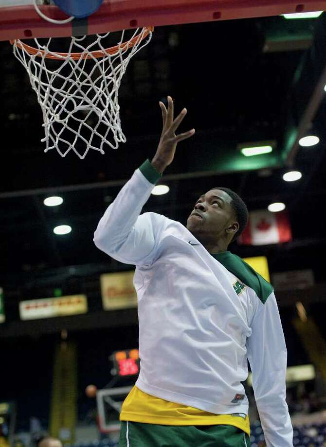 Siena's OD Anosike warms up before of a MAAC men's quarterfinals college basketball game against Manhattan in Springfield, Mass., Saturday, March 3, 2012. (Jessica Hill / Special to the Times Union) Photo: Jessica Hill