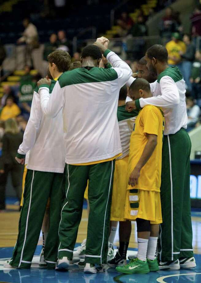 Siena huddles before of a MAAC men's quarterfinals college basketball game against Manhattan in Springfield, Mass., Saturday, March 3, 2012. (Jessica Hill / Special to the Times Union) Photo: Jessica Hill