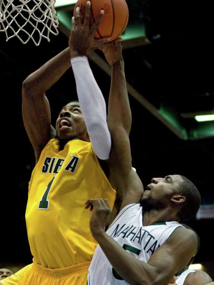 Siena's OD Anosike drives to the basket Manhattan's Mohamed Koita, right, defends in the first half of a MAAC men's quarterfinals college basketball game in Springfield, Mass., Saturday, March 3, 2012. (Jessica Hill / Special to the Times Union) Photo: Jessica Hill