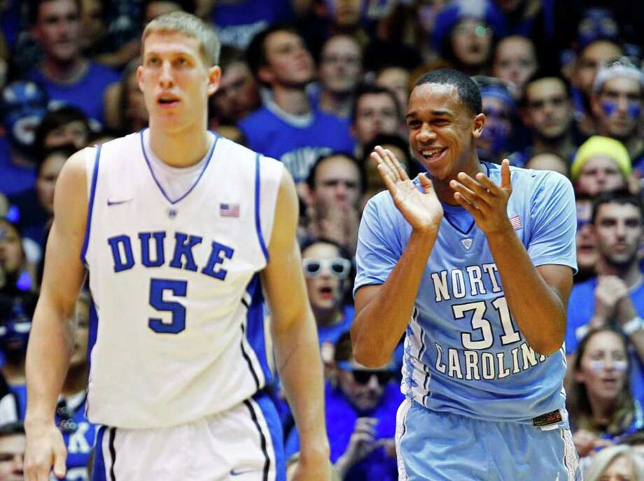 Duke's Mason Plumlee (5) walks away as North Carolina's John Henson (31) reacts following a basket during the first half of an NCAA college basketball game in Durham, N.C., Saturday, March 3, 2012. North Carolina won 88-70. (AP Photo/Gerry Broome) Photo: Gerry Broome