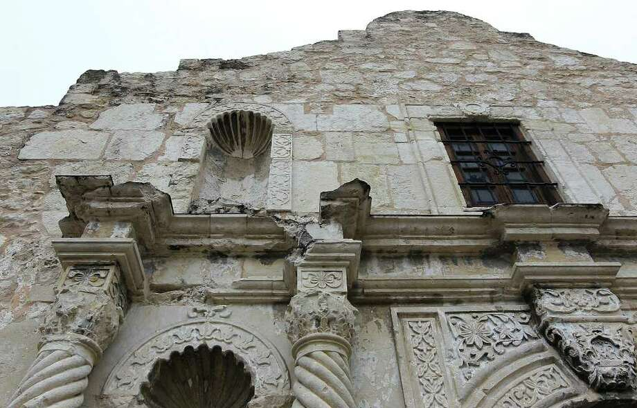 Images of the facade of the Alamo in its current state. Deteriation along the cornice of the facade has been stemmed with added flashing to prevent moisture from building up on the limestone rock. Efforts are being made to preserve the shrine but funding is needed for continued assessments and additional preservation projects. Photo: Kin Man Hui, San Antonio Express-News / © 2012 San Antonio Express-News