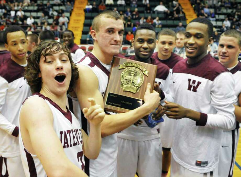'Vliet players celebrate their victory over Cohoes in the Section II Class B boys' basketball final at the Glens Falls Civic Center Saturday March 3, 2012.   (John Carl D'Annibale / Times Union) Photo: John Carl D'Annibale / 00016626A