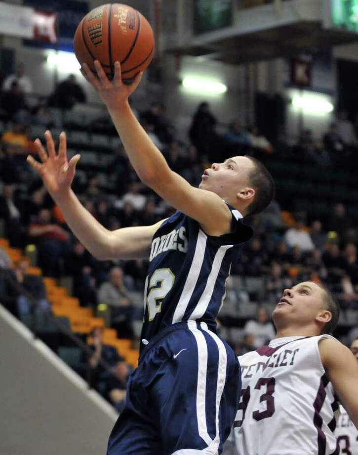 Cohoes' #12, Elijah Newsome, left, gets past 'Vliet defenders during the Section II Class B boys' basketball final at the Glens Falls Civic Center Saturday March 3, 2012.   (John Carl D'Annibale / Times Union) Photo: John Carl D'Annibale / 00016626A