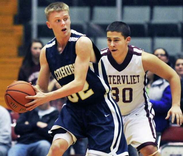 Cohoes' #32, Nate Monson. left, and 'Vliet's #30 Jose Sanchez during the Section II Class B boys' ba