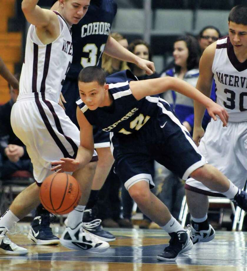 Cohoes' #12, Elijah Newsome tries to get through 'Vliet defenders during the Section II Class B boys' basketball final at the Glens Falls Civic Center Saturday March 3, 2012.   (John Carl D'Annibale / Times Union) Photo: John Carl D'Annibale / 00016626A