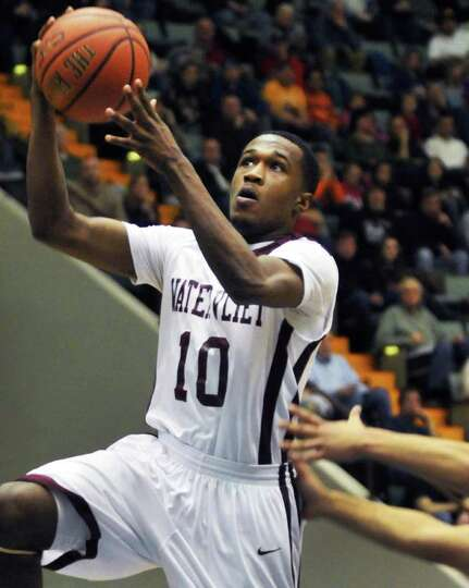 Watervliet's #10, Tyler McLeod goes to the basket against Cohoes in the Section II Class B boys' bas
