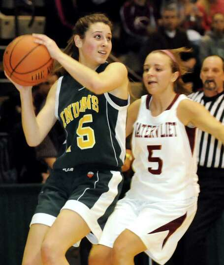 Ravena's Hope Rebeor (15), left, looks to pass as Watervliet's Alyssa Chartrand (5) defends during t