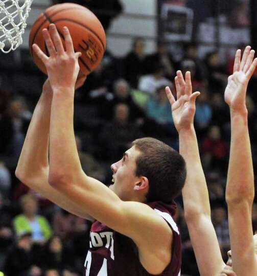 Scotia's # 24 Joe Cremo shoots during the Section II Class A boys' basketball final against Bishop G