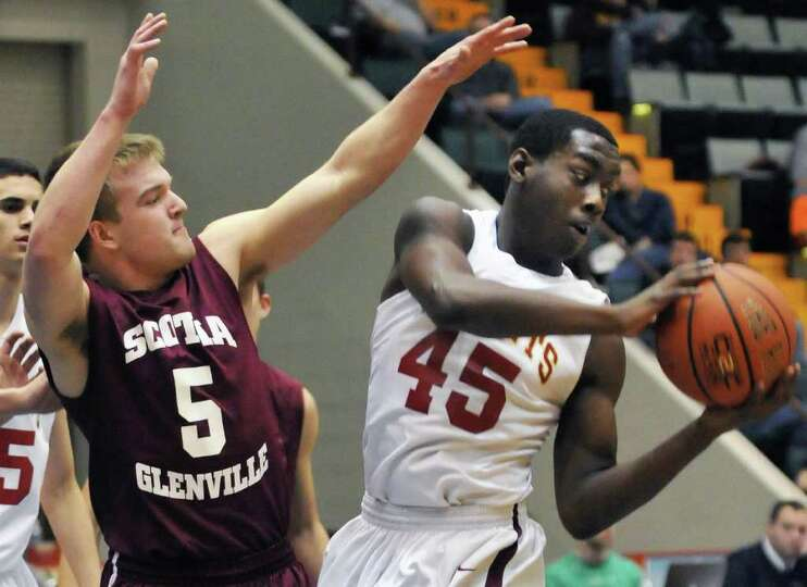 Scotia's # 5, Matt Renko, left, and Bishop Gibbons' #45 Zeke Beckford during the Section II Class A