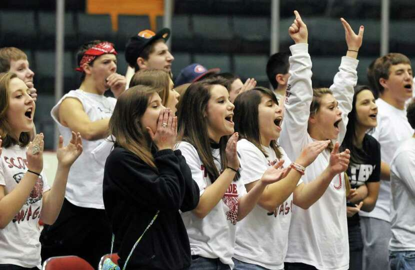 Scotia fans cheer as their team beats Bishop Gibbons in the Section II Class A boys' basketball fina